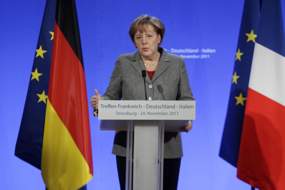 German Chancellor Angela Merkel gestures as she speaks to the media during a joint press conference in Strasbourg, eastern France, Thursday, Nov 24, 2011.  The leaders of Germany, France and Italy are set for debate on the European Central Bank's role in the region's debt crisis and on how to align eurozone economic policies. (AP Photo/Michel Euler)