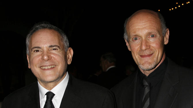 """FILE - This Nov. 15, 2007 file photo shows Craig Zadan, left, and Neil Meron, producers of the film """"Hairspray"""" at the Santa Barbara International Film Festival's Kirk Douglas Award for Excellence in Film presented to actor John Travolta in Santa Barbara, Calif. The producers behind the last two Oscar telecasts are coming back for a third time. The film academy announced Monday, April 21, 2014, that Zadan and Meron will return to produce the 87th annual Academy Awards held on Feb. 22, 2015. (AP Photo/Michael A. Mariant, file)"""