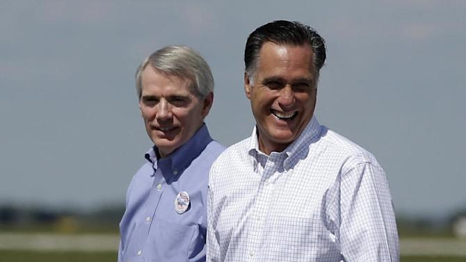 Republican presidential candidate Mitt Romney and Sen. Rob Portman, R-Ohio arrive in Mansfield, Ohio, Monday, Sept. 10, 2012. (AP Photo/Charles Dharapak)