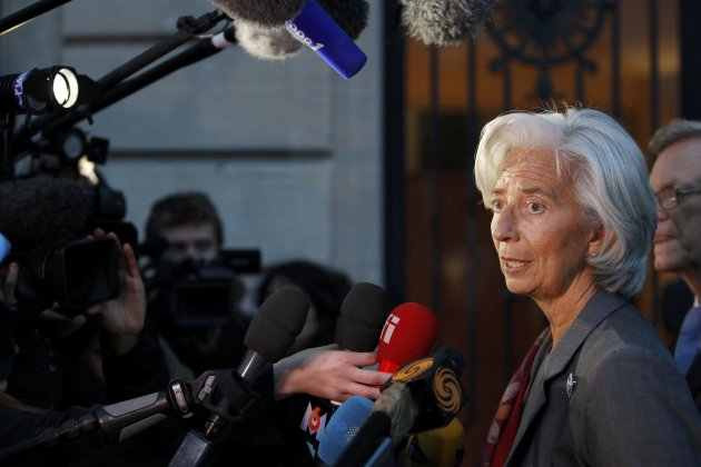 IMF chief Lagarde speaks to journalists as she leaves after a hearing by French magistrates in Paris
