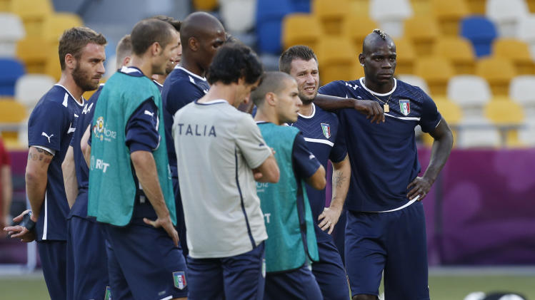 Italy's Mario Balotelli, right, stands alongside teammate Antonio Cassano during a training session ahead of Sunday's Euro 2012 soccer championship final  between Spain and Italy in Kiev, Ukraine, Saturday, June 30, 2012. (AP Photo/Jon Super)