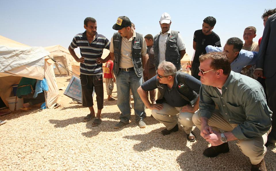 Jordanian Foriegn Minister Nasser Judeh , center and his Canadian counterpart  John Baird, right,visit  Zaatari camp for Syrian refugees  in Mafraq, Jordan, Saturday, Aug. 11, 2012.  (AP photo/Mohammad Hannon)
