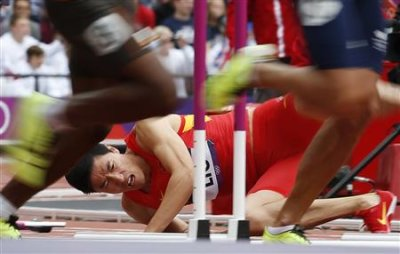 China&amp;#39;s Liu Xiang falls after hitting a hurdle in his men&amp;#39;s 110m hurdles heat. (Reuters)