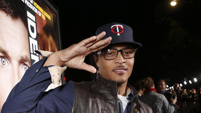 """Tip """"T.i."""" Harris attends the world premiere of """"Identity Thief"""" at the Mann Village Westwood on Monday, Feb. 4, 2013 in Los Angeles. (Photo by Todd Williamson/Invision/AP Images)"""