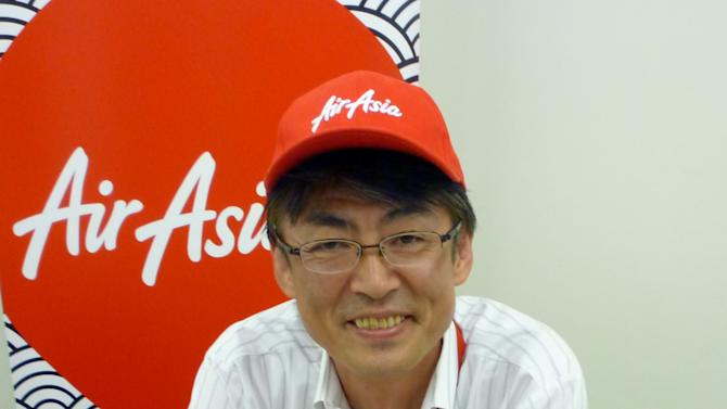 "In this Sept. 28, 2012 photo, AirAsia Japan President Kazuyuki Iwakata smiles during an interview in Tokyo. ""It's not that the meals on standard fares were ever free. The charge was just part of the ticket price,"" Iwakata told The Associated Press. ""With us, people pay only for what they need."" As a marketing ploy, AirAsia Japan, which started operations in August, offered tickets for just 5 yen (5 cents) to the first 10,000 people. They quickly sold out. (AP Photo/Yuri Kageyama)"