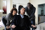 "In this film image released by The Weinstein Company, Anne Le, left, Francois Cluzet, and Omar Sy, right, are shown in a scene from ""The Intouchables."" (AP Photo/The Weinstein Company, Thierry Valletoux)"