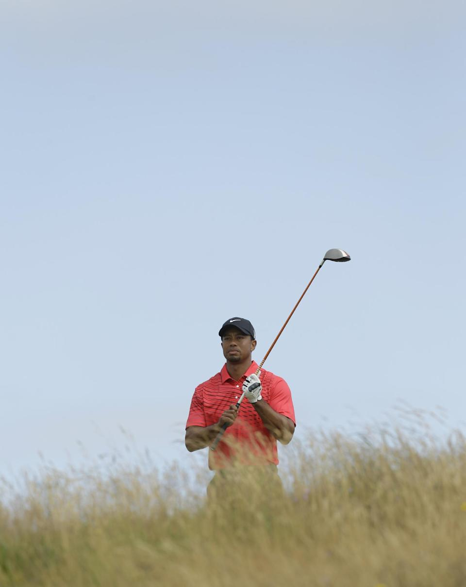 Tiger Woods of the United States plays a shot off the 11th tee at Royal Lytham & St Annes golf club during the final round of the British Open Golf Championship, Lytham St Annes, England Sunday, July  22, 2012. (AP Photo/Jon Super)