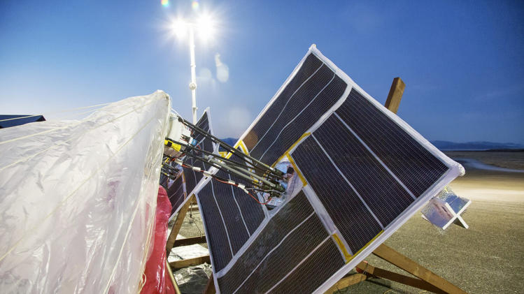 In this June 10, 2013 photo released by Google, solar panels and electronics are prepared for launch in Tekapo, New Zealand. Google is testing balloons which sail in the stratosphere and beam the Internet to Earth. (AP Photo/Google, Andrea Dunlap) EDITORIAL USE ONLY