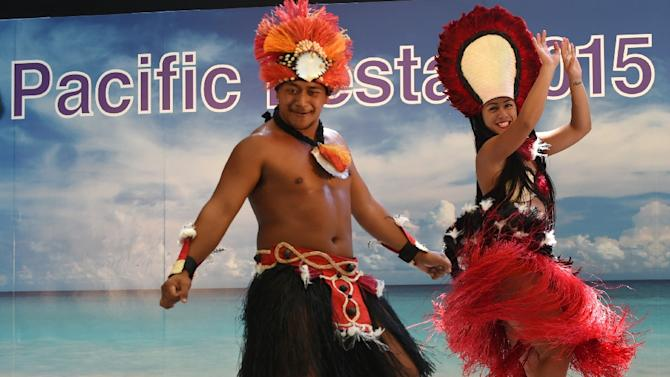 Dancers from Cook Islands perform onstage during the Pacific Festa in Tokyo, on May 21, 2015