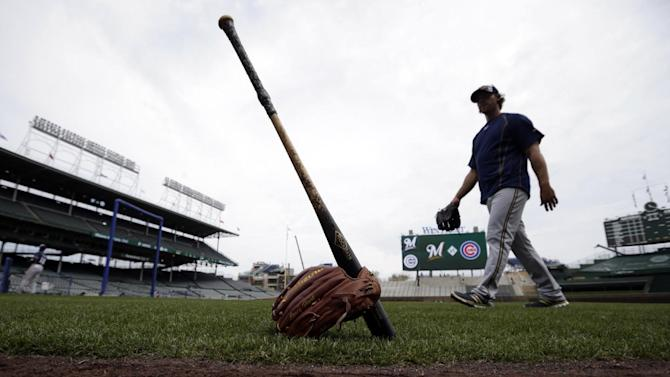 Milwaukee Brewers relief pitcher Neal Cotts walks into the dugout during batting practice before a baseball game against the Chicago Cubs in Chicago, on Sunday, May 3, 2015. (AP Photo/Jeff Haynes)