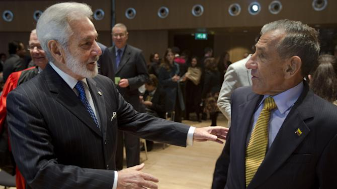 Samuel Santos, minister of foreign affairs of Nicaragua, left, goes to shake hands with agent Julio Londono Paredes of Colombia, right, as the court delivered its ruling in the case of Nicaragua versus Colombia at the International Court of Justice in The Hague,  Netherlands, Monday, Nov. 19, 2012.  The court is ruling on a long-running dispute between Nicaragua and Colombia over ownership of islands in the western Caribbean and the maritime border between the countries. (AP Photo/Peter Dejong)