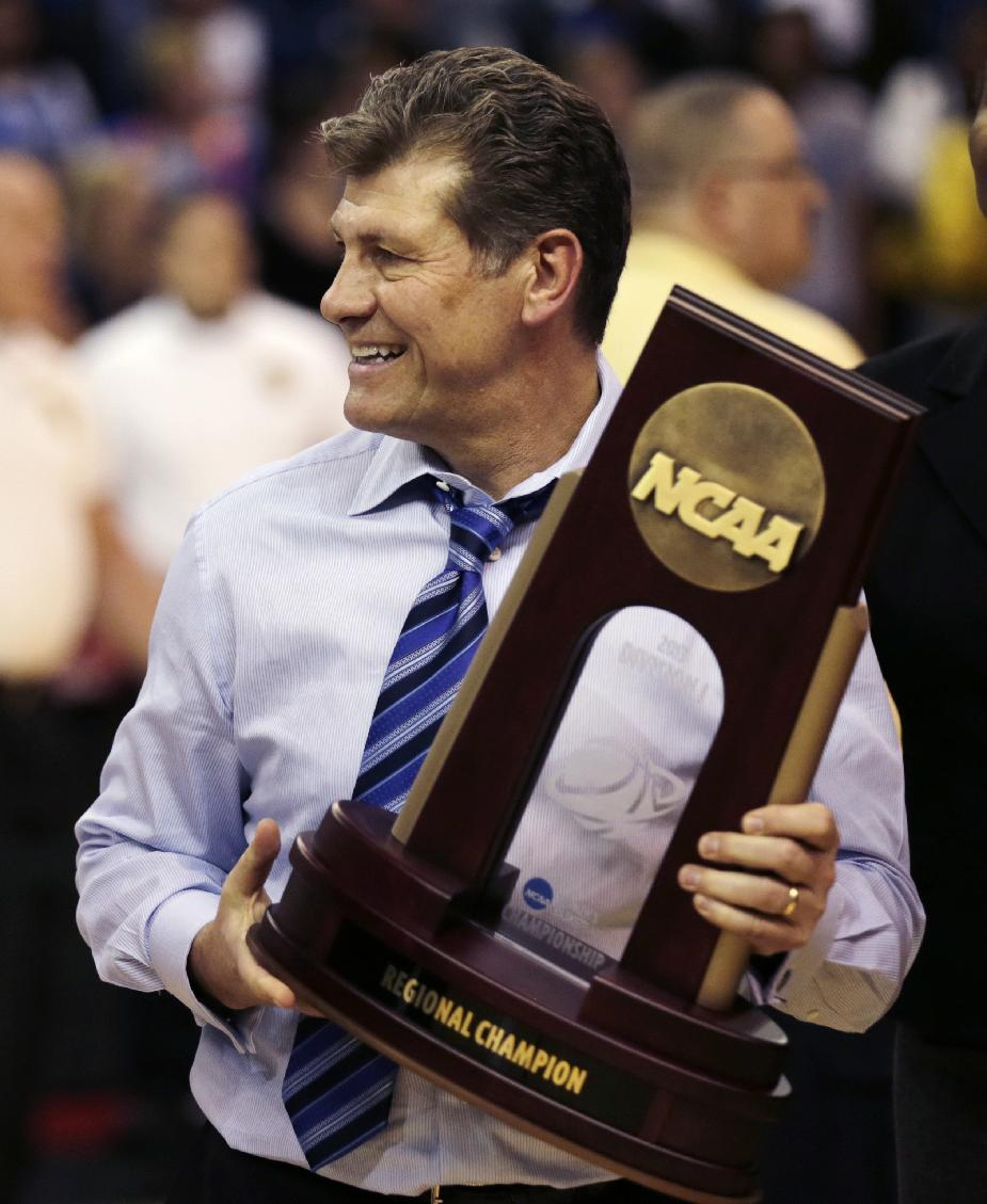 Connecticut head coach Geno Auriemma smiles after beating Kentucky in the women's NCAA regional final basketball game in Bridgeport, Conn., Monday, April 1, 2013. Connecticut won 83-53 and advances to the Final Four. (AP Photo/Charles Krupa)