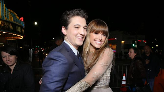 "Miles Teller and Sarah Wright at the LA premiere of ""21 and Over"" at the Westwood Village Theatre on Thursday, Feb. 21, 2013 in Los Angeles. (Photo by Eric Charbonneau/Invision/AP)"
