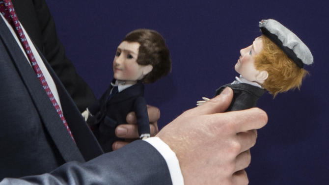 "Britain's Prince Harry, right, and British Prime Minister David Cameron hold customized dolls created by MakieLab which were given to them during a meeting with entrepreneurs during the ""GREAT Event"" in New York, Tuesday, May 14, 2013.  (AP Photo/Brendan McDermid, Pool)"