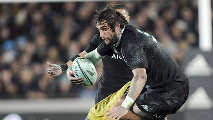 New Zealand's Sam Whitelock is tackled by Australia during the International test Bledisloe Cup rugby match at Eden Park in Auckland, New Zealand, Saturday, Aug. 23 2014. (AP Photo/SNPA, Ross Setford) NEW ZEALAND OUT