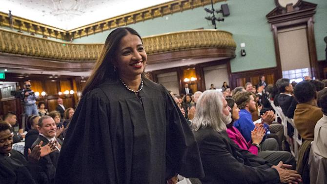 Newly appointed city judge Raja Rajeswari from Chennai, India rises to take her place for a Judicial Swearing-In Ceremony at New York City Hall in New York