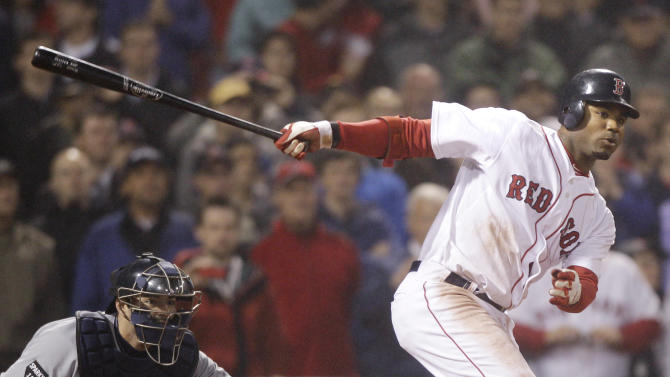 Boston Red Sox's Carl Crawford, right, watches his game-winning, bases-loaded single in the bottom of the ninth inning against the Detroit Tigers during an MLB baseball game at Fenway Park in Boston, Thursday, May 19, 2011. The Red Sox won 4-3. Tigers catcher Alex Avila, left, looks on. (AP Photo/Charles Krupa)