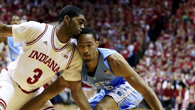 North Carolina's J.P. Tokoto, right, is defended by Indiana's Maurice Creek during the first half of an NCAA college basketball game, Tuesday, Nov. 27, 2012, in Bloomington, Ind. (AP Photo/Darron Cummings)