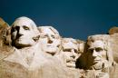 """FILE - In this undated photo, the statues of George Washington, Thomas Jefferson, Teddy Roosevelt and Abraham Lincoln are shown at Mount Rushmore in South Dakota. Theodore Roosevelt and two more Roosevelts who occupied the White House, President Franklin Delano Roosevelt and his first lady, Eleanor, are the subjects of a new Ken Burns documentary for public television, """"The Roosevelts: An Intimate History."""" (AP Photo, File)"""