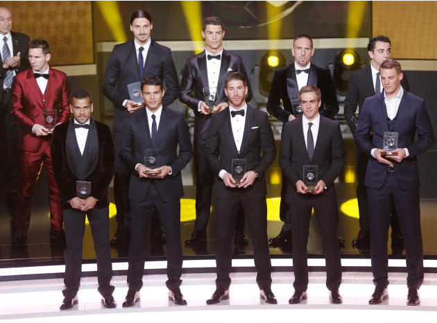 "The FIFA ""dream team"" with the best goal keeper, defenders, midfielders and forwards stands on the stage at the FIFA Ballon d'Or 2013 Gala in Zurich, Switzerland, Monday, Jan. 13, 2014."