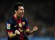 Barcelona&#39;s Argentinian forward Lionel Messi celebrates after scoring his second goal during the Spanish League Clasico football match FC Barcelona vs Real Madrid CF at the Camp Nou stadium in Barcelona. The match ended in a 2-2 draw