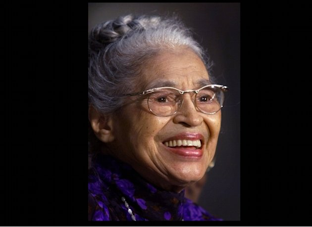 FILE -- In a June 15, 1999 file photo Rosa Parks smiles during a Capitol Hill ceremony where  Parks was honored with the Congressional Gold Medal in Washington.   Parks will become the first black wom