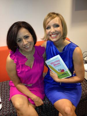 """This Sept. 11, 2012  image released by Yfat Reiss Gendell shows Alicia Ybarbo, left, and Mary Ann Zoellner, two of four authors of """"Sh*tty Mom,"""" posing with their book in New York. The latest in irreverent parenting books is part parody and part painful truth. It's written by four very busy, often tired working moms looking to offer some overdue LOLs as counterpoint to today's parenting-to-perfection mania. (AP Photo/Yfat Reiss Gendell)"""
