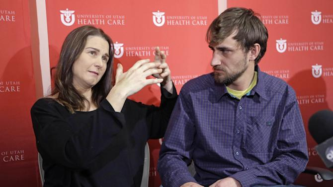 Elisabeth Malloy, avalanche survivor, and skiing partner and initial rescuer Adam Morrey discuss their ordeal during a news conference at the University of Utah Health Care's Burn Center Wednesday, Jan. 16, 2013, in Salt Lake City. Malloy suffered frost bite in her toes and fingers, but emerged otherwise unscathed from Saturday's near-death encounter in the mountains east of Salt Lake City. She survived thanks to her boyfriend, Adam Morrey, avalanche rescue beacons, a skier that wandered by and avalanche rescue teams.  (AP Photo/Rick Bowmer)
