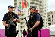 "British police guard the athletes village at the Olympic Park site in Stratford, east London. The head of private security giant G4S has agreed under questioning by British lawmakers that the firm's failure to provide enough security guards for the Olympics was ""a humiliating shambles"""