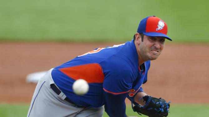 FILE - In this March 11, 2015, file photo, New York Mets starting pitcher Matt Harvey throws during a pring training baseball game against the Miami Marlins in Jupiter, Fla. Harvey is scheduled to pitch for the Mets against the St. Louis Cardinals on Thursday, April 2, in the final game of spring training for the two teams. (AP Photo/John Bazemore, File)