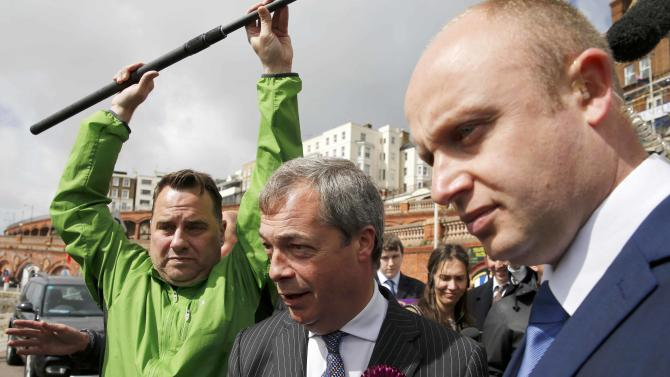 Nigel Farage, leader of the United Kingdom Independence Party, is escorted from a campaign event in Ramsgate, southern England
