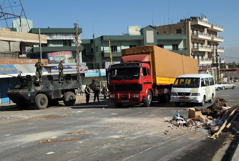 Vehicles are seen on the Beirut-Baalbek highway in Chtoura, Lebanon, Friday, June 21, 2013. Lebanese troops opened the highway a day after it was closed by anti-Assad rebels to protest a siege imposed by Shiite gunmen on the eastern town of Arsal. (AP Photo)