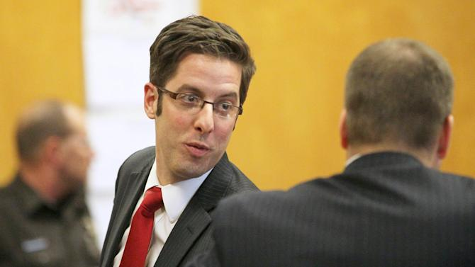 Defense attorney Anthony Cotton, left, speaks with Waukesha Asst. District Attorney Ted Szczupakiewicz after a hearing at the county court in Waukesha, Wis. on Thursday, Dec. 18, 2014 during the trial for two 12-year-old girls accused of stabbing another girl in May 2014. The two girls told detectives the attack was an attempt to please Slenderman, a fictional character they found on a horror website. (AP Photo/Milwaukee Journal-Sentinel, Michael Sears)