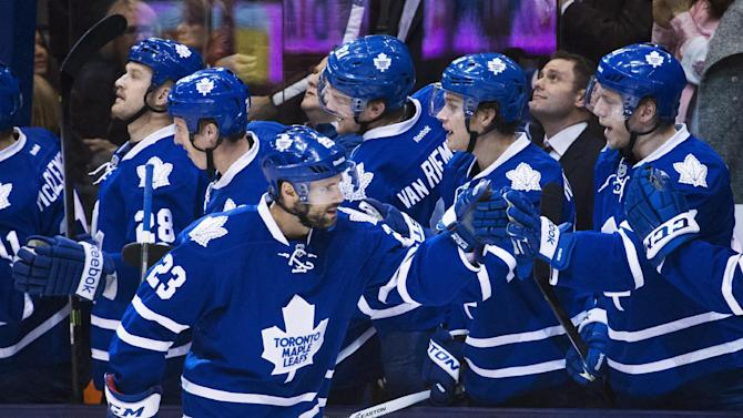 Toronto Maple Leafs' Trevor Smith celebrates his goal against the New York Islanders during the first period of an NHL hockey game, Tuesday, Nov. 19, 2013 in Toronto