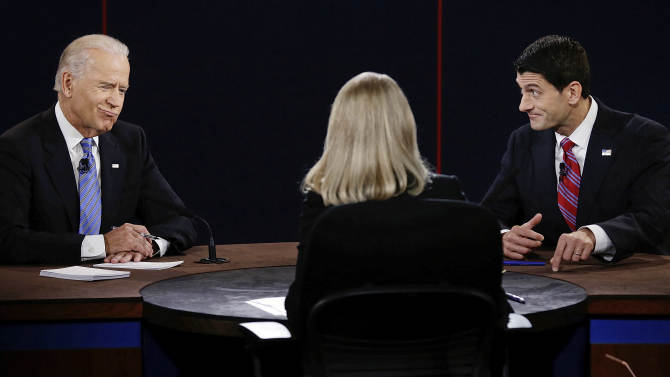 Vice President Joe Biden and Republican vice presidential nominee Rep. Paul Ryan, of Wisconsin, participate in the vice presidential debate at Centre College, Thursday, Oct. 11, 2012, in Danville, Ky. (AP Photo/Charlie Neibergall)