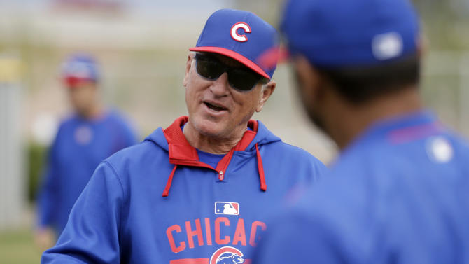 Chicago Cubs manager Joe Maddon talks during a spring training baseball workout Sunday, March 1, 2015, in Mesa, Ariz. (AP Photo/Morry Gash)