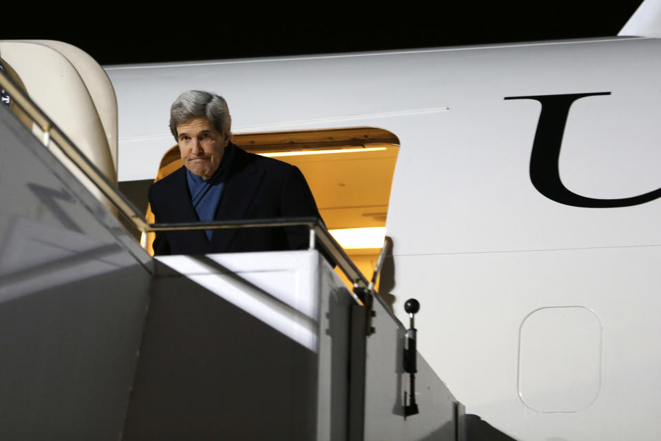 U.S. Secretary of State John Kerry ducks under the doorway as he arrives at Tegel International Airport in Berlin on Monday, Feb. 25, 2013, the second stop in Kerry's first official trip overseas as secretary. (AP Photo/Jacquelyn Martin, Pool)