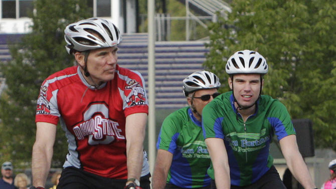 "This photo made Saturday, Aug. 11, 2012, in Columbus, Ohio, shows U.S. Sen. Rob Portman, R-Ohio, wearing the red jersey, riding in Pelotonia with his son Will Portman, right.  Portman said his views on gay marriage began changing in 2011 when his son, Will, then a freshman at Yale University, told his parents he was gay and that it wasn't a choice but ""part of who he was."" Portman said he and his wife, Jane, were very surprised but also supportive. (AP Photo/Jay LaPrete)"