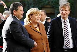 SPD party leader Gabriel welcomes German Chancellor and leader of the CDU party Merkel in Berlin