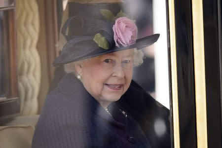 Britain's Queen Elizabeth takes her seat in a State Carriage for the carriage procession to Buckingham Palace in London