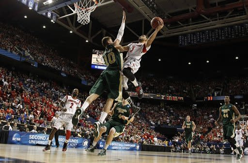Louisville runs over Colorado State 82-56 at NCAAs