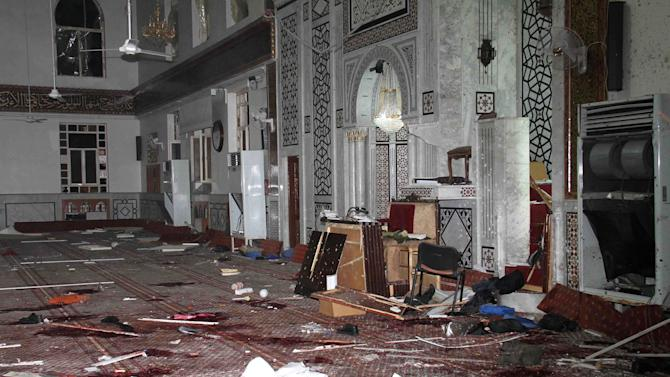 In this photo released by the Syrian official news agency SANA, the Eman Mosque is seen destroyed after a suicide bomber blew himself up, killing Sheikh Mohammad Said Ramadan al-Buti, an 84-year-old cleric known to all Syrians as a religious scholar, at the Mazraa district, in Damascus, Syria, Thursday, March 21, 2013. A suicide bomber blew himself up during evening prayers inside a mosque in Damascus Thursday, killing a top Sunni Muslim preacher and longtime supporter of President Bashar Assad and least 13 other people, state TV reported. Al-Buti's death is a big blow to Syria's embattled leader, who is fighting mainly Sunni rebels seeking his ouster. (AP Photo/SANA)