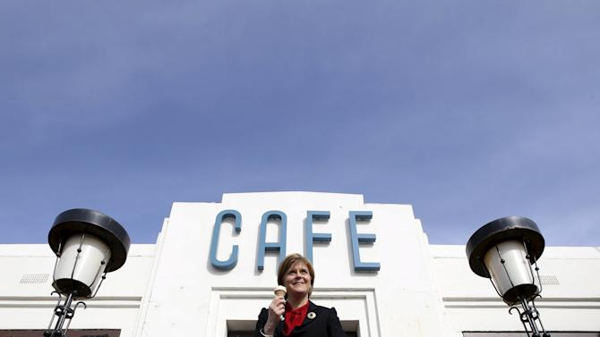 Leader of the Scottish National Party Nicola Sturgeon poses for a photograph outside Nardini's ice cream parlour and cafe, Largs, Scotland