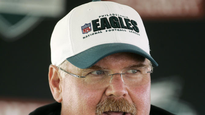FILE - This July 30, 2011 file photo shows Philadelphia Eagles head coach Andy Reid talking with the media after the morning session at NFL football training camp at Lehigh University in Bethlehem, Pa. Reid arrived in Kansas City on Friday, Jan. 4, 2012, and the Chiefs are close to making an official announcement that he will become their next coach. (AP Photo/Rich Schultz, File)