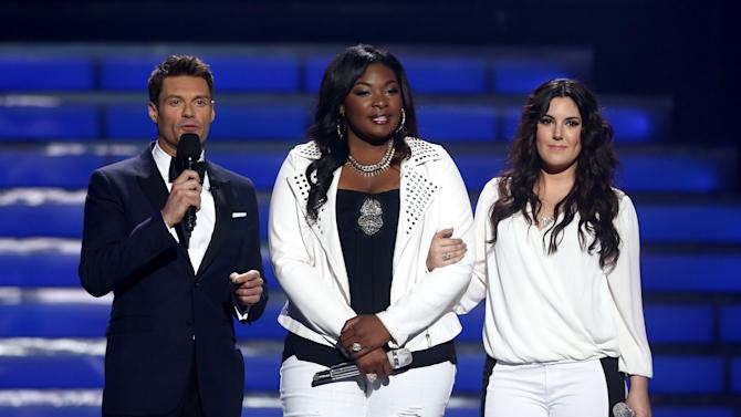 """Host Ryan Seacrest, left, and finalists Candice Glover, center, and Kree Harrison speak on stage at the """"American Idol"""" finale at the Nokia Theatre at L.A. Live on Thursday, May 16, 2013, in Los Angeles. (Photo by Matt Sayles/Invision/AP)"""