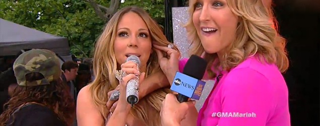 Mariah Carey's dress pops its back buttons on live TV. (GMA)