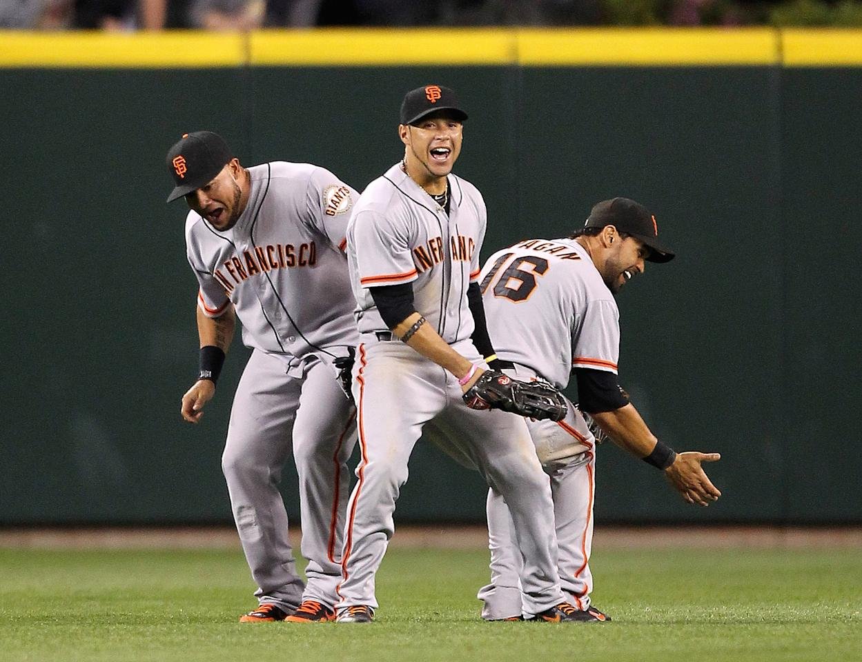 SEATTLE, WA - JUNE 15:  L to R: Melky Cabrera #53, Gregor Blanco #7, and Angel Pagan #16 of the San Francisco Giants celebrate after defeating the Seattle Mariners 4-2 at Safeco Field on June 15, 2012 in Seattle, Washington.(Photo by Otto Greule Jr/Getty Images)