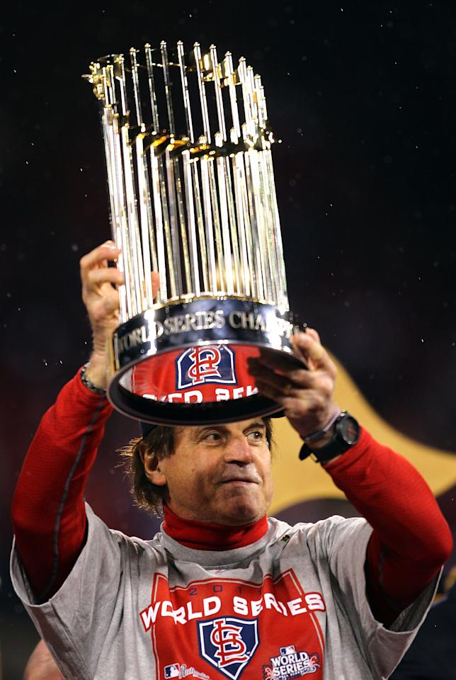 ST LOUIS, MO - OCTOBER 28:  Manager Tony La Russa holds up the World Series trophy after defeating the Texas Rangers 6-2 in Game Seven of the MLB World Series at Busch Stadium on October 28, 2011 in St Louis, Missouri.  (Photo by Dilip Vishwanat/Getty Images)