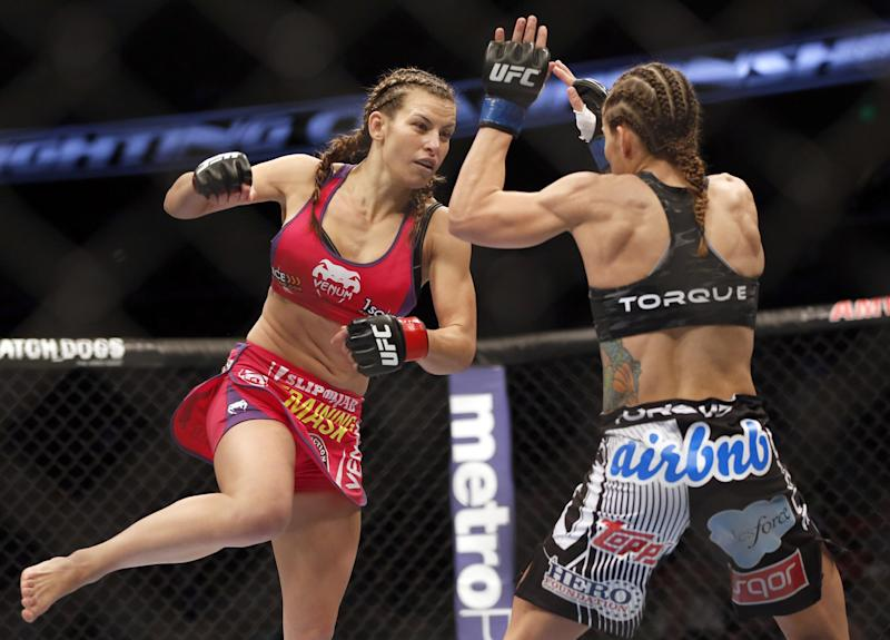 Miesha Tate, left, and Liz Carmouche fight in a mixed martial arts event on Saturday, April 19, 2014, at UFC Fight Night in Orlando Fla. Tate defeated Carmouche
