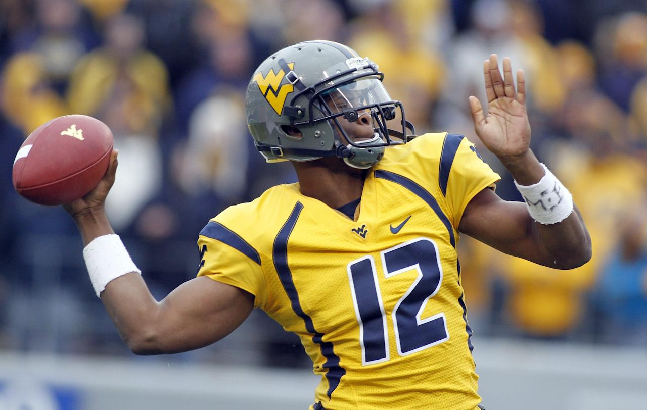 MORGANTOWN, WV - NOVEMBER 03:  Geno Smith #12 of the West Virginia Mountaineers drops back to pass against the TCU Horned Frogs during the game on November 3, 2012 at Mountaineer Field in Morgantown, West Virginia.  (Photo by Justin K. Aller/Getty Images)